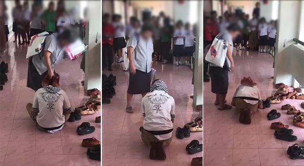 ครูเอารองเท้าวางบนหัวนักเรียน